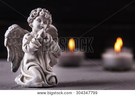 Mourning Concept. Little Angel And Burning Candles On  Dark Background. Card For Mourning, Death, So