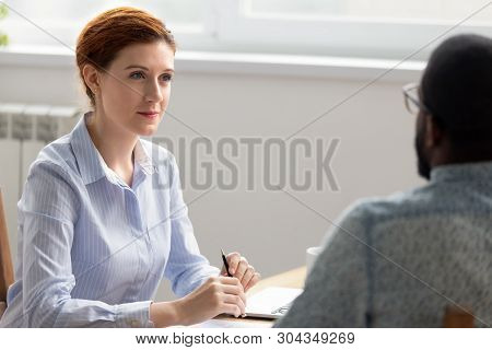 Business Owner Boss Interviewing Male Black Job Candidate In Office