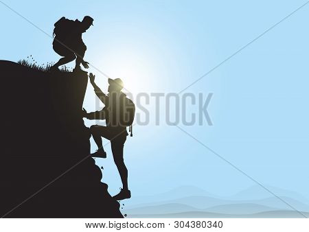 Silhouette Of Two People Hiking Climbing Mountain And Helping Each Other On Blue Sky Background, Hel