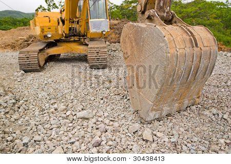 Road works.Excavator. poster