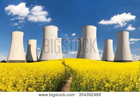 Nuclear Power Plant Jaslovske Bohunice Cooling Towers With Golden Flowering Field Of Rapeseed, Canol