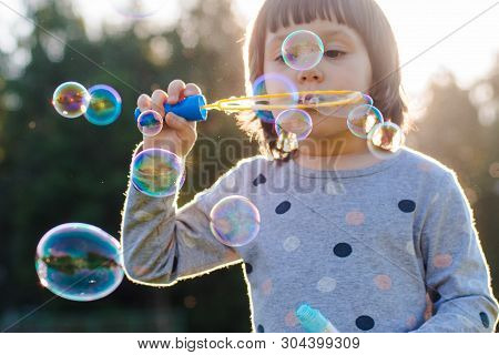 Kids Little Girl Blowing Bubbles On The Playground With Sunset Background, Kids, Baby, Preschooler,