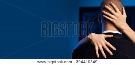 Couple Indoors. Close Up Woman Hug Man In Elegant Formal Business Suit. Female Hands On The Man Bald