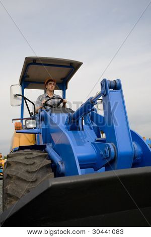 construction worker driving a bulldozer on a building site