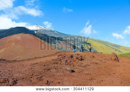 Mount Etna, Sicily, Italy - April 9th 2019: Tourists Admiring The Volcanic Landscape Around Etna Vol