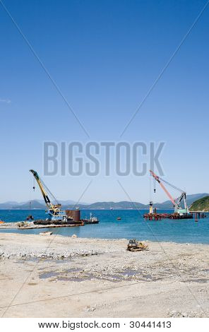 Construction of new seaport(oil harbor).Floating cranes.