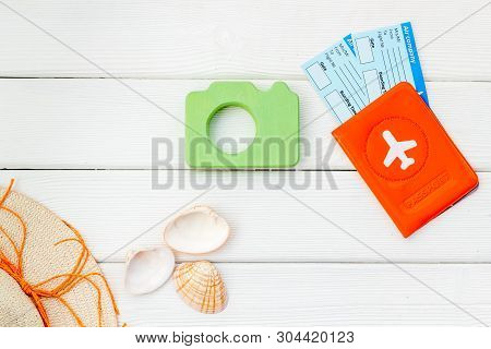 Funny Vocation Concept With Camera, Hat, Passport And Tickets On White Wooden Background Top View