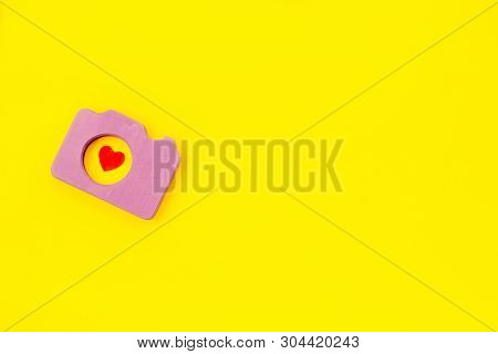 Photo Camera Concept With Heart On Yellow Background Top View Mock Up