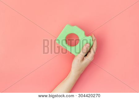 Photo Camera Concept With Hand On Pink Background Top View Mock Up