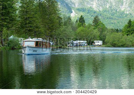 Slovenia, Bohinj: 26. May 2019: Colorful Panorama Of The Bohinj Lake At Ukanc. Picturesque Moning In