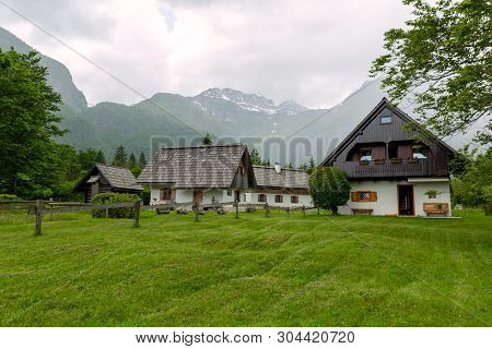 Slovenia, Bohinj: 26. May 2019: Colorful Spring Panorama Of The Ukanc Village. Picturesque Moning Sc