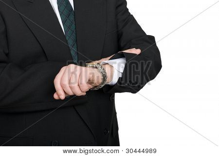 Businessman checking the time on his wristwatch.
