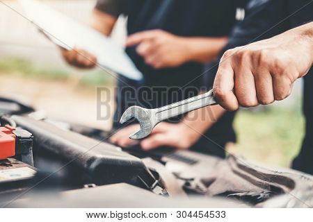 Auto Mechanic Working In Garage Technician Hands Of Car Mechanic Working In Auto Repair Service And