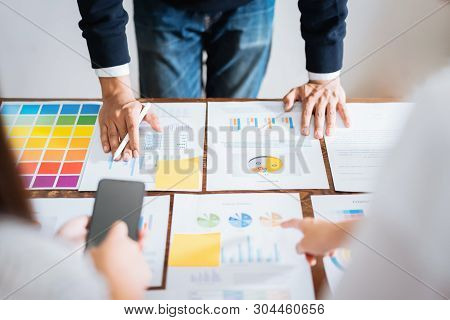 Business People Meeting Team Working On Wooden Desk And Hand  Man Pointing To Financial Documents In