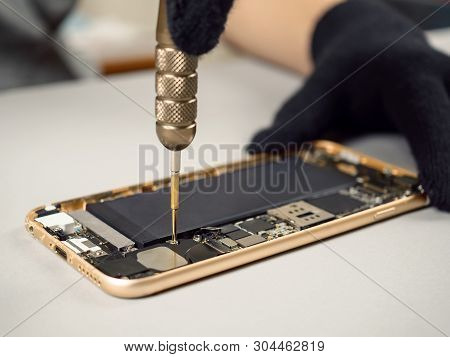 Technician Or Engineer Disassembling Components Broken Smartphone For Repair Or Replace New Part On
