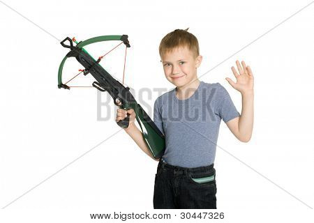 Smiling boy holding a crossbow for children.