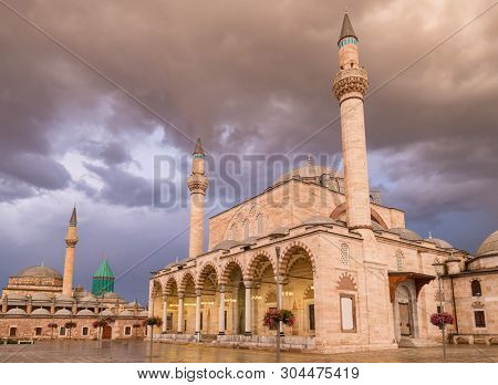 Mevlana Museum  and Selimiye Mosque at the central square of the old town of Konya, Turkey poster