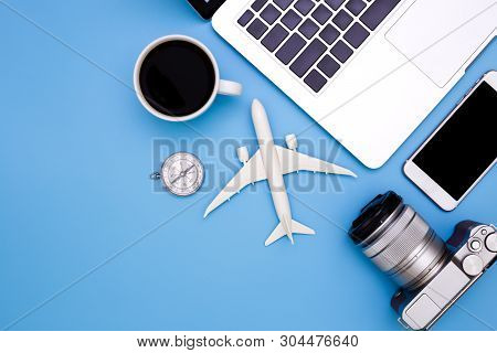 Summer Concept On Blue Blackground With Laptop, Flat Lay Of Modern Workplace With Laptop On Blue Bac