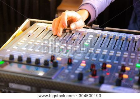 Detail Of A Music Mixer In Studio, Mixing Table With Buttons And Volume Controls. Stock Photo Of Clo