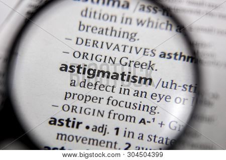 The Word Or Phrase Astigmatism In A Dictionary Book.