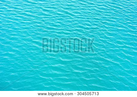Blue Rippled Water As Abstract Background. Tranquil Surface Texture Of The Sea. Water Ripples Of A L