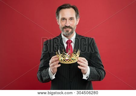 Monarchy attribute. Monarchy family traditions. Man bearded guy in suit hold golden crown symbol of monarchy. Become king ceremony. Award and achievement. Feeling superiority. Being superior human. poster