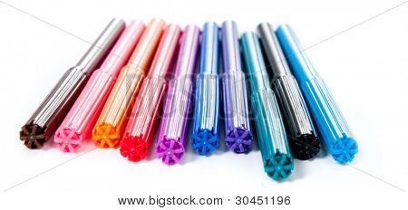 set of colored markers on white background