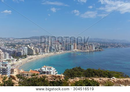 La Fossa Beach Calp Spain Costa Blanca With People View From The Famous Rock Landmark