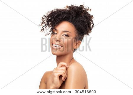 Beauty Portrait Of African American Woman With Clean Healthy Skin On White Background. Skin Care And