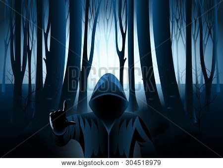 Hooded Man In Dark Mysterious Forest, Strange Light In Paranormal Landscape At Night. The Silhouette