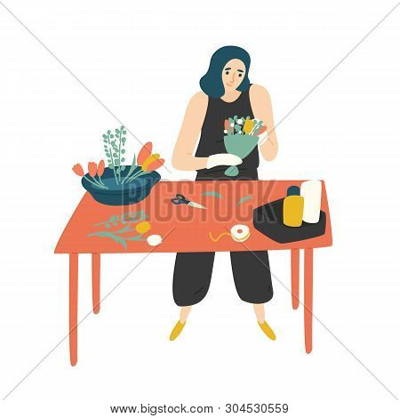 Cute Happy Woman Standing At Table And Making Bouquet. Smiling Female Florist At Floristry Shop. Fun