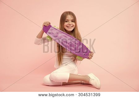 Happy little girl with penny board. Little girl happy smiling with penny board. Regenerate energy skating from day to night. Vital energy. A skateboard you can trust. poster