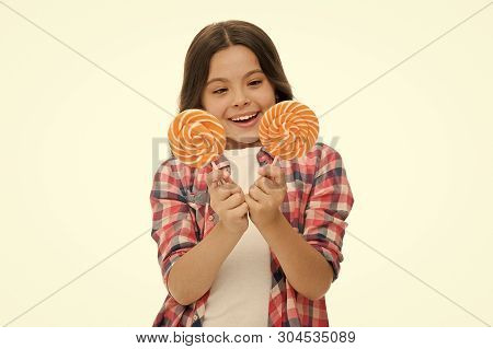 Hard choice. Girl hold two lollipops in hands isolated white. Girl can not decide which lollipop she want. Sweets addicted kid. Which one alternative decision. Make your choice. Pick one lollipop. poster