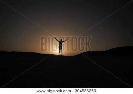Achieve Main Goal. Silhouette Man Stand Proud In Front Of Sunset Sky Background. Future Success Depe