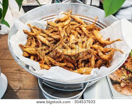 Small Crispy Fish, Fried Fish Capelin In Metal Bowl Closeup