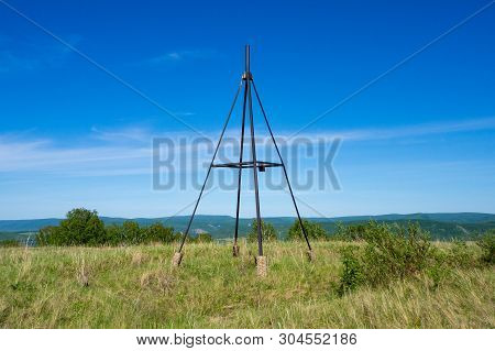 Beautiful, Summer Landscape. Metal Tower On Top Of A Hill. Geodesic, Triangulation Point.