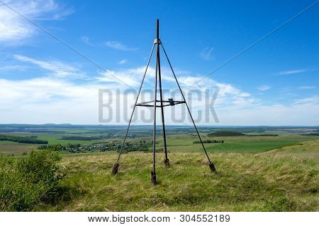 Metal Tower On Top Of A Hill. Geodesic, Triangulation Point. Beautiful, Rural Landscape.