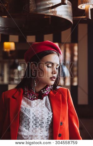 Very Beautiful Brunette Model With Blue Eyes In Retro Clothes: Pink Takes, White Blouse, Red Jacket