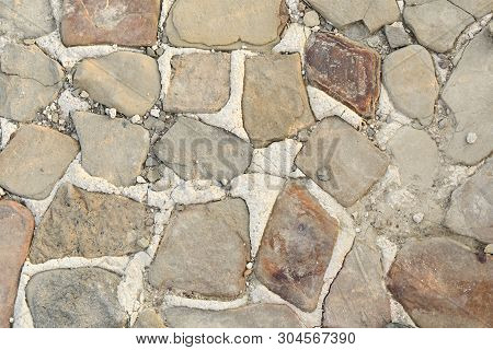 The Flooring Is Lined With Natural Stone And Cement Sand Mixture