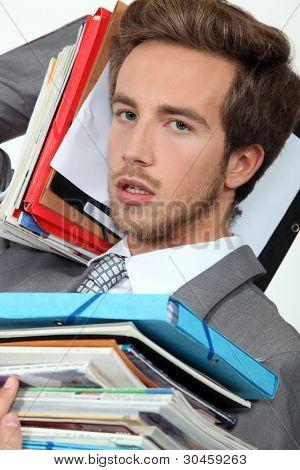 Male office worker under pressure