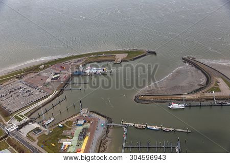 Aerial View Harbor And Industrial Park Lauwersoog At Dutch Coast Of Wadden Sea