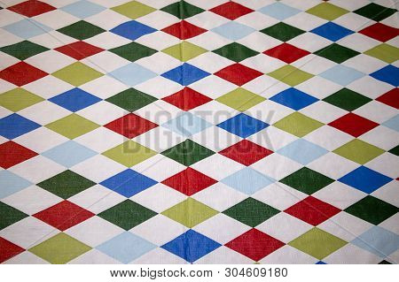 A Multicolored Table Cloth In A Checkered Pattern