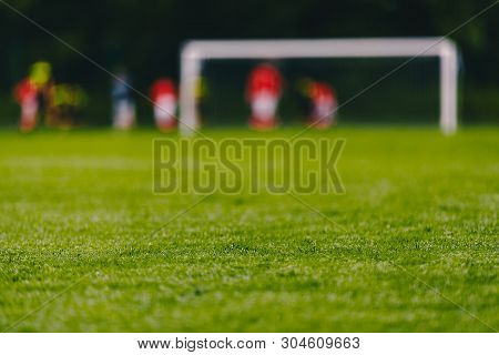 Football Soccer Field. Low Angle Image Of Green Turf On Soccer Pitch