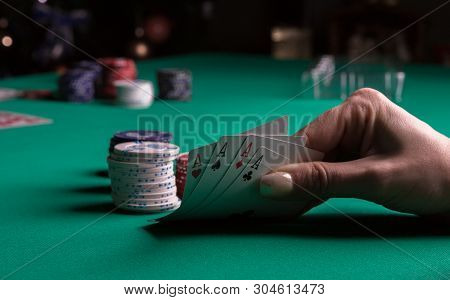 Poker Table During A Game. Four Aces Cards Holding