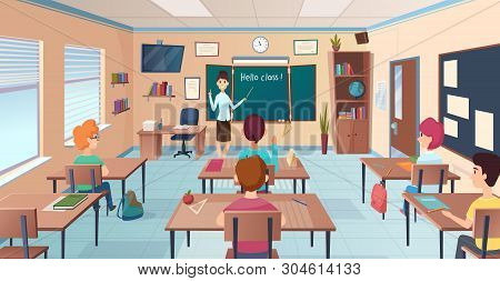 Lesson In Classroom. Pupils At Desks And Teacher Standing And Pointing Kids Study Near Chalkboard Ve