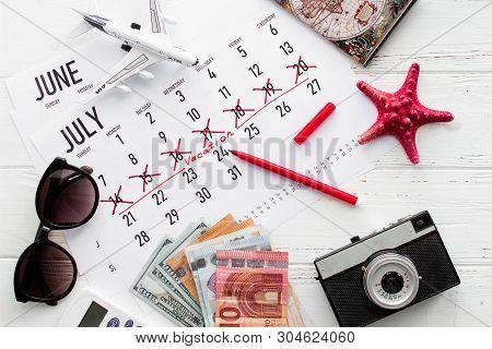 Vacation Planning Concept. Travel Preparation: Camera, Money, Passport, Vacation Plan Written On Cal