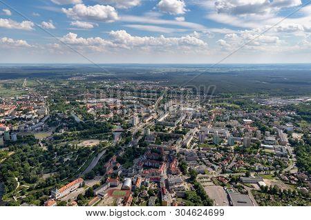 Pila, wielkopolskie / Polska - June, 2, 2019: A view from a glider on a medium-sized city in Poland.