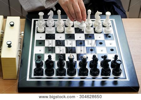 The Girl Walks A Pawn In The Debut Of The Chess Game. Special Kit For The Blind Or Travelers. Game A