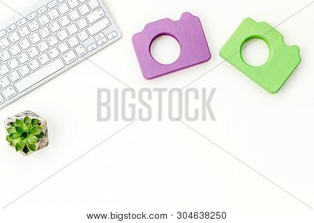 Blogger Table Design With Photo Camera, Keyboard And Plant On White Background Top View Mockup