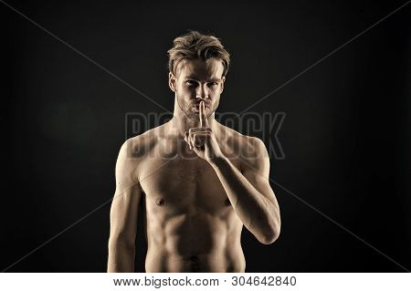 Bodybuilder Show Silence Finger Gesture. Sportsman With Sexy Chest And Belly. Bearded Man Athlete Wi